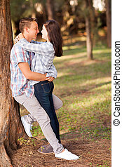 teenage couple embracing - romantic teenage couple embracing...