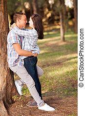 teenage couple embracing