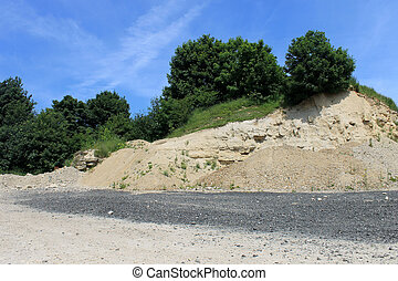 Old stone quarry - Scenic view of old stone quarry in...