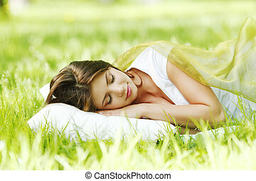 Woman sleeping on grass - Young woman sleeping on soft...