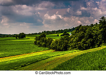 Farm fields and hills in  rural Southern York County, Pennsylvania.