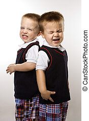 Twin boy brothers crying - Caucasian twin boys crying...