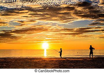 Fishing silhouette on Lang Co beach, Hue, Vietnam