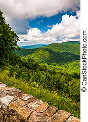 Stone wall and view of the Blue Ridge at an overlook on...