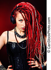 red style - Expressive girl in headphones with great red...