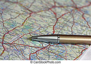 Road Map and Ballpoint Pen - Ballpoint pen over road map of...