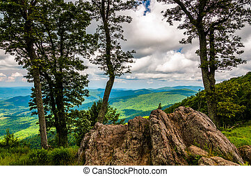 Boulders, trees, and view of the Blue Ridge at an overlook...