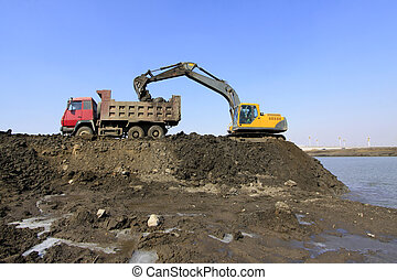 busy excavator at the construction site of water conservancy...