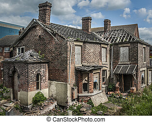 Derelict House - Abandoned and boarded up old house with...