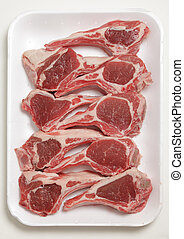 Lamb chops on a tray - A supermarket polystyrene tray of...