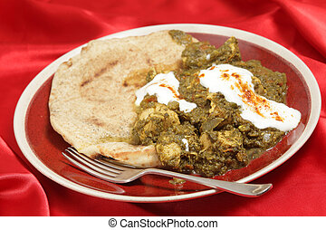 Chicken saag with bread and yoghurt - Chicken saag curry,...