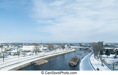 country sight view with river  in winter ,Hokkaido , Japan