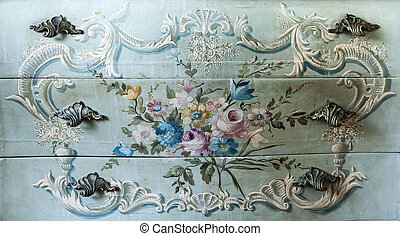 Detail of drawer carving with flowers and handles