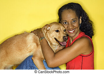 Smiling woman with dog.