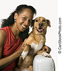 Woman with mixed breed dog.