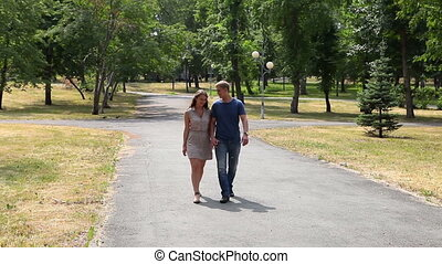 Summer walk - Lovely young couple walking together in the...