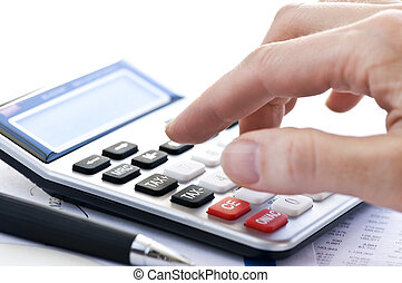 Tax calculator and pen - Typing numbers for income tax...