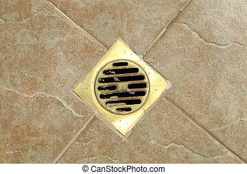 sewer grate drain water on the tile floor in bathroom