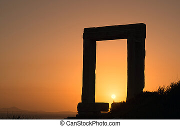 Ancient gate of Apollon temple at sunset on Naxos island,...