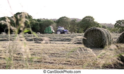 Tractor harvesting a field - A tractor is harvesting the...
