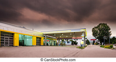 mystic mood at oil petrol filling station with tree