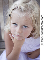 Little girl looking at camera - 4 year old serious child...