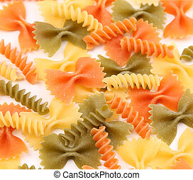different pasta in three colors close-up. background