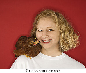 Woman with chicken on shoulder.