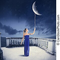 Take the Moon - Young girl takes the Moon with rope.Moon...