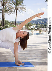 Woman stretching yoga - Middle aged senior woman doing yoga...