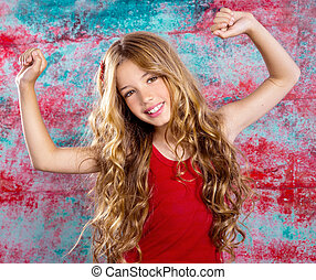 Blond happy children girl in red happy arms up - Blond happy...