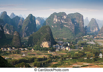 chinese rural scenery of karst mountain at dusk in yangshuo