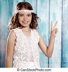 Happy hippie children girl smiling with peace hand sign -...