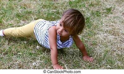 Active child - Close-up of an active little girl enjoying...