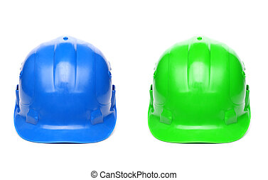 Blue and green hard hats isolated on a white background