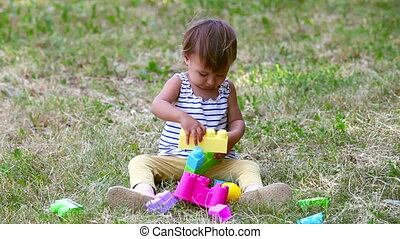 Little constructor - Adorable child playing with...