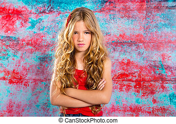 Angry gesture blond children girl with closed arms...