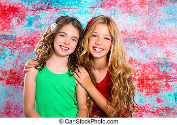 friends beautiful children girls hug together happy smiling...