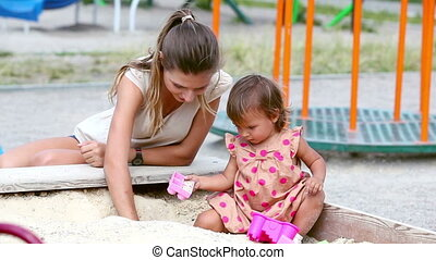 Sandbox summer - Charming family of two playing in the...