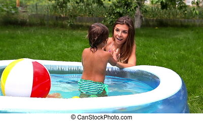 Kid in pool - Adorable little girl spending time outdoors in...