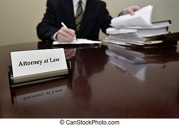 Attorney at Desk with Business Card - Attorney at Law...