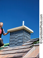 Chimney covered with slate tiles - Roofer checking a house...