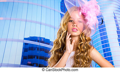 blond fashion girl with pink hat in blue skyscrapers