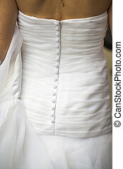 bridal gown - back of a bridal gown with white buttons