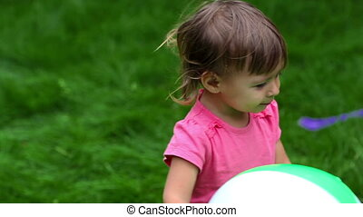 Toddler outdoors - Close-up of a lovely toddler holding a...
