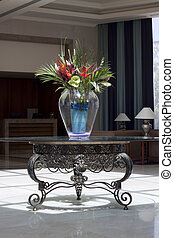 Hotel lobby - Reception area with vase set up with a lavish...