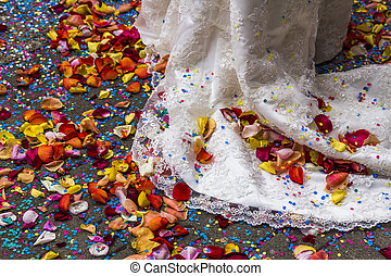 bridal gown with confetti and rose petals - train of an...
