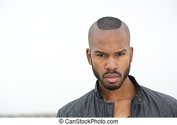 Handsome black man looking at camera - Portrait of a...