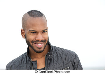 Portrait of a handsome young black man smiling - Close up...
