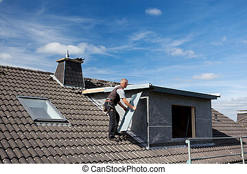 Roofer carrying a metal piece to the dormer - Roofer...